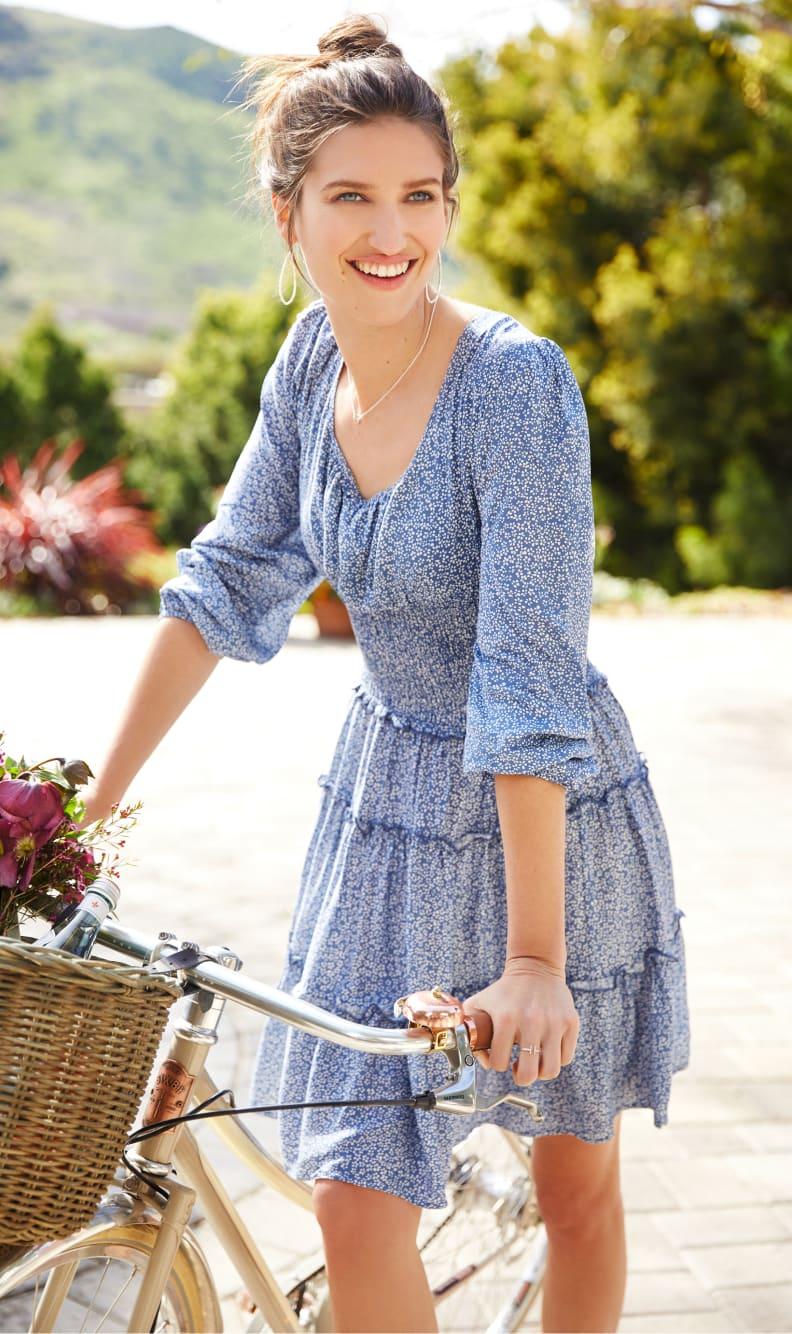 Woman walking her bike