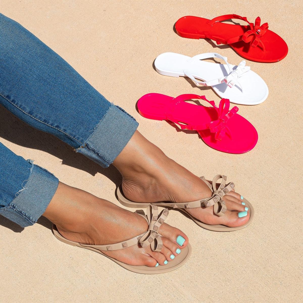 $16.99 (reg $30) Bow Matte Studs Jelly Sandals
