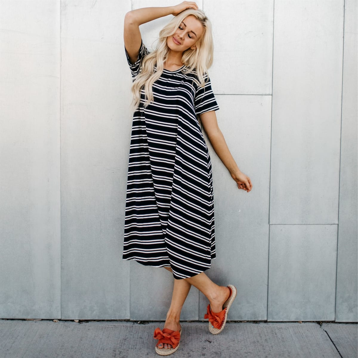 Summer dresses: woman wearing a mid length black & white swing dress.