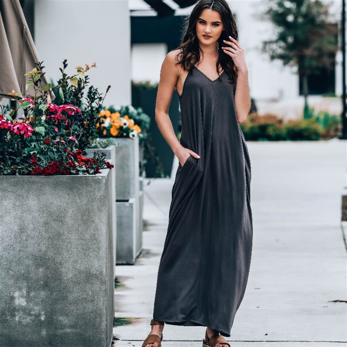 Summer dresses: Woman wearing a spaghetti strap maxi dress in black.