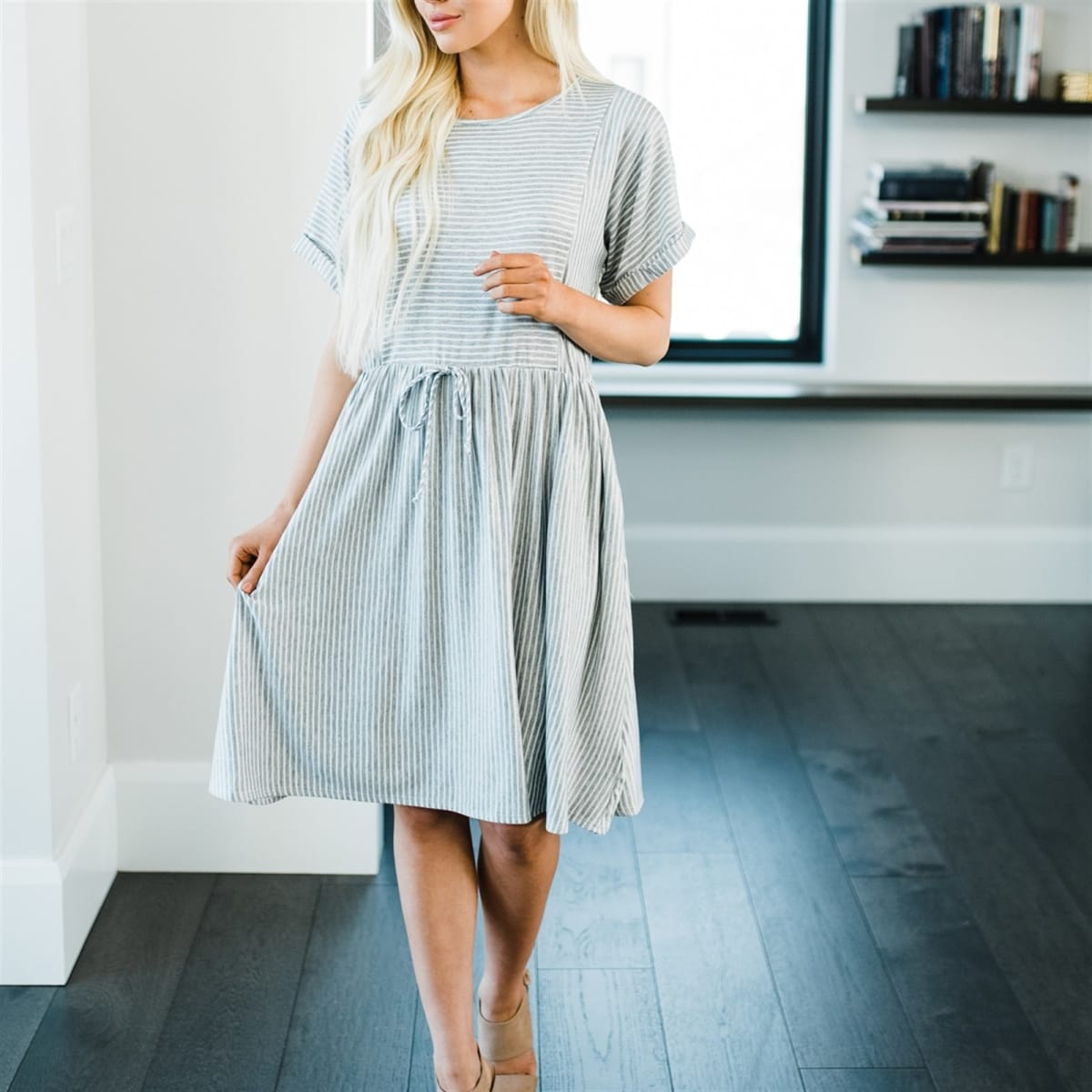 Summer dresses: woman wearing an above the knee striped dress