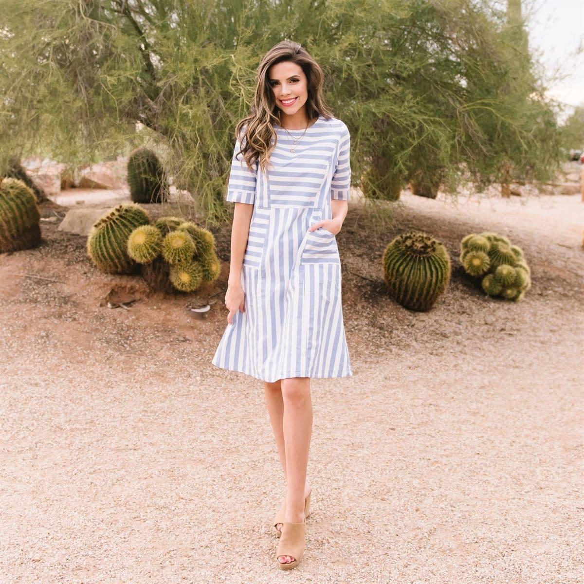 Summer dresses: woman wearing a blue & white striped dress