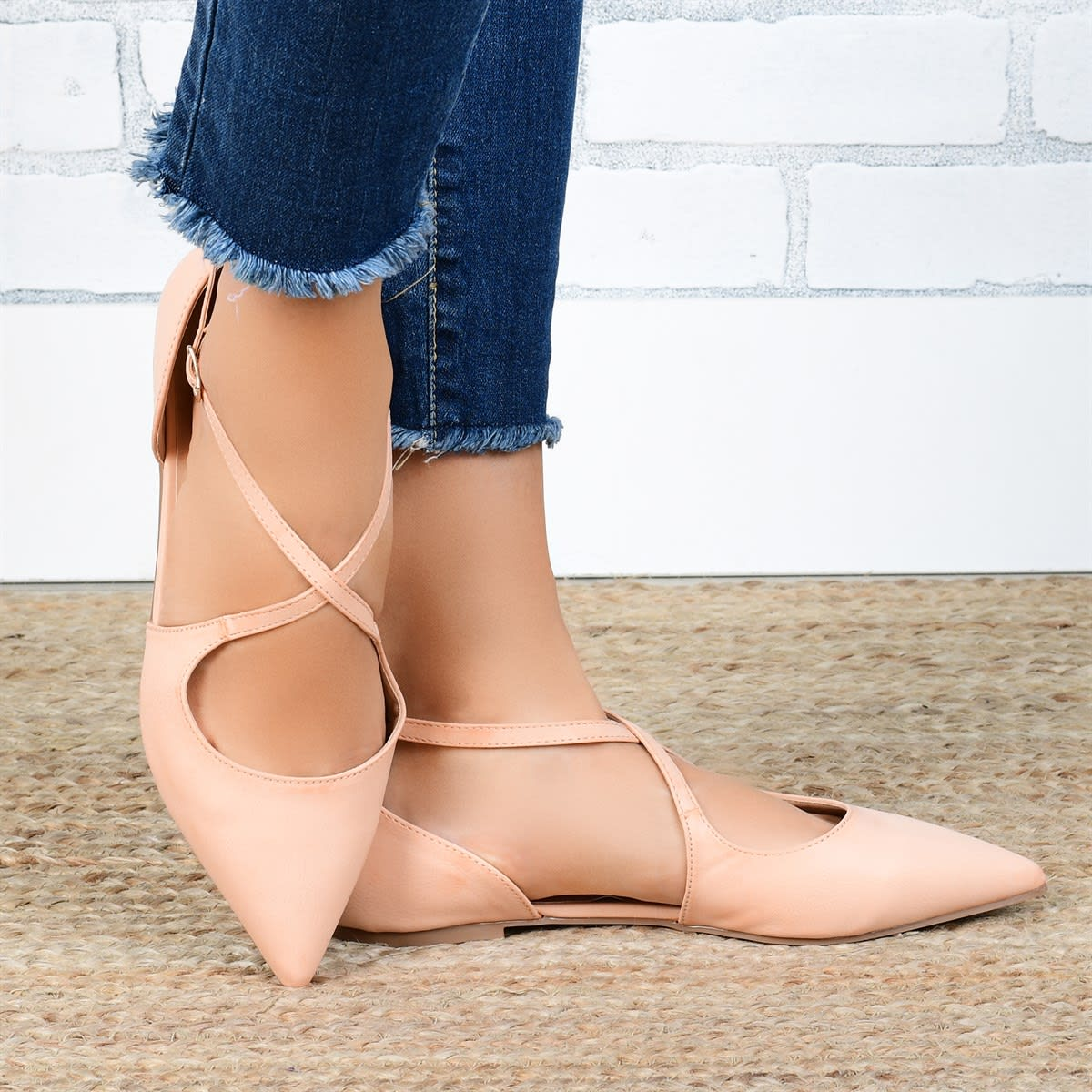 pointed toe crossover flats